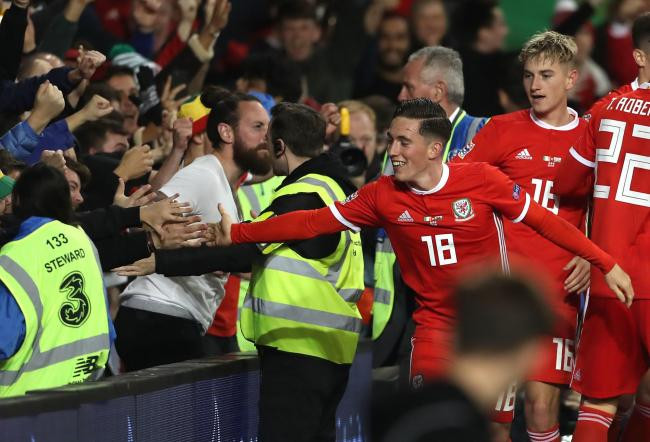 WINNER: Harry Wilson celebrates with the Wales fans in Dublin after scoring the goal to beat the Republic of Ireland