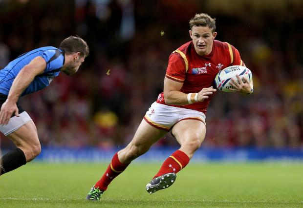 Penarth Times: WORLD CUP: Hallam Amos on the run against Uruguay at England 2015