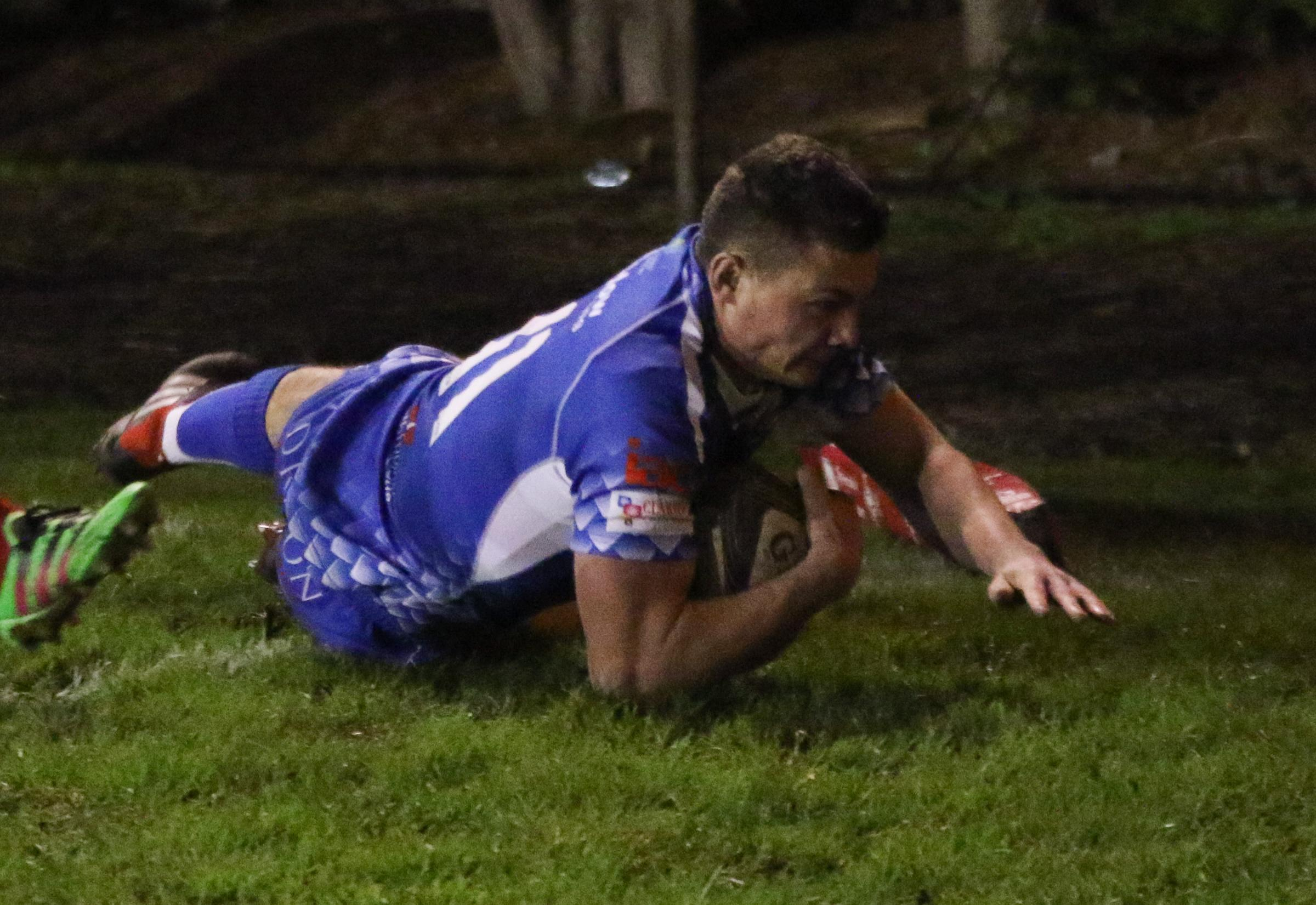 HERO: Deon Smith, pictured scoring for the Dragons, won it at the death for Wales U20s
