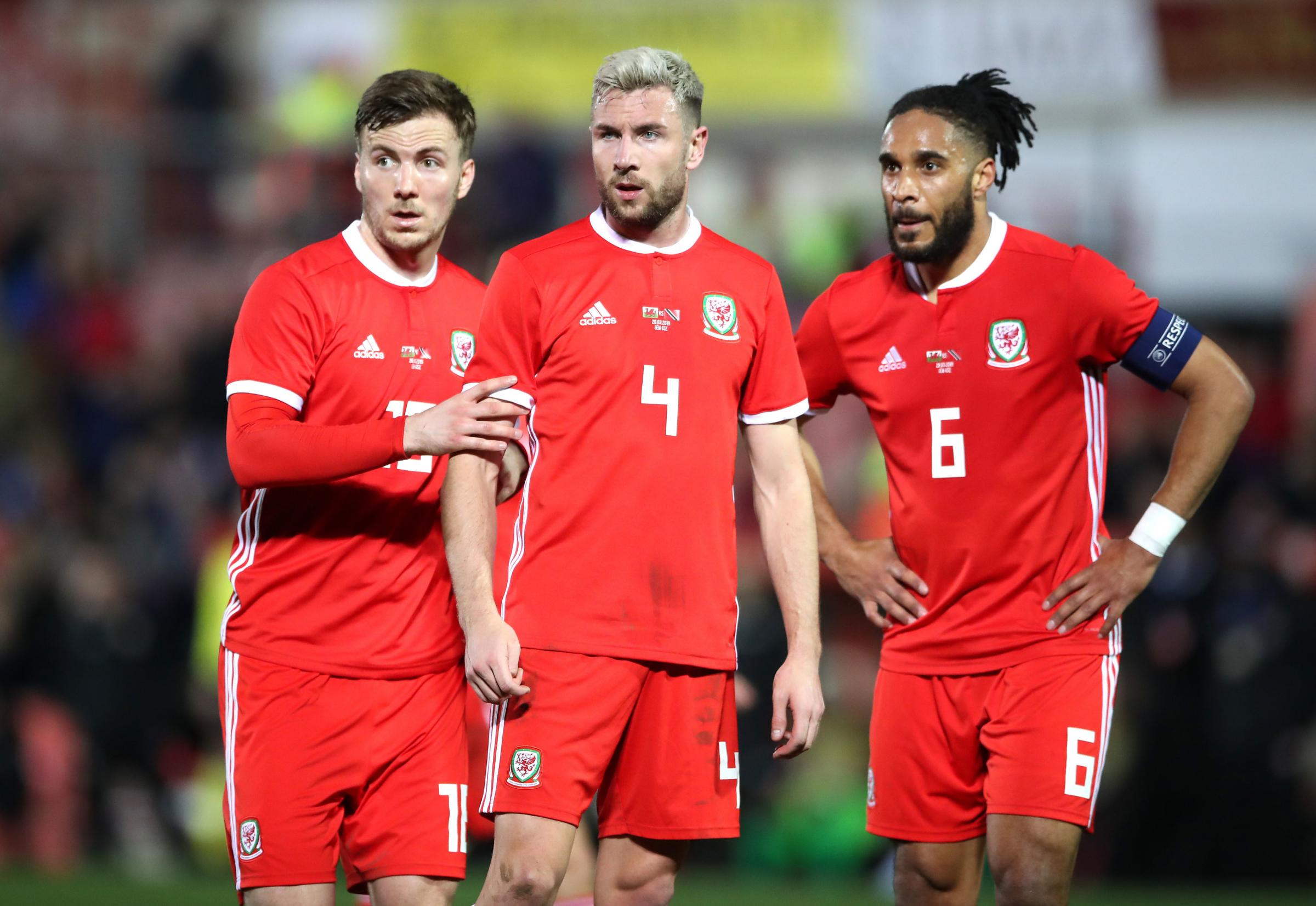 FOCUSED: Newport's Lee Evans, left, with Paul Dummett and Ashley Williams