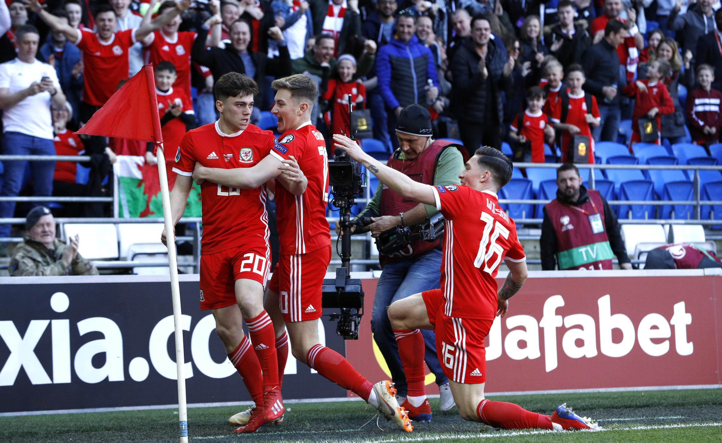 VICTORY: Goal scorer Daniel James, left, celebrates with Wales teammates David Brooks, centre, and Harry Wilson on Sunday