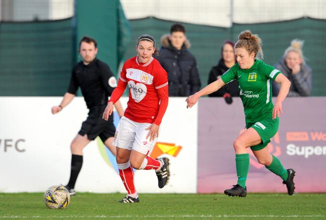 TON UP: Loren Dykes, left, in action for Bristol City this season. Picture: Nizaam Jones/JMP
