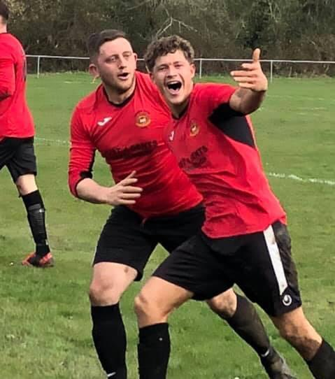 David Shallis, with Liam Wingren, after scoring Penarth's fourth goal