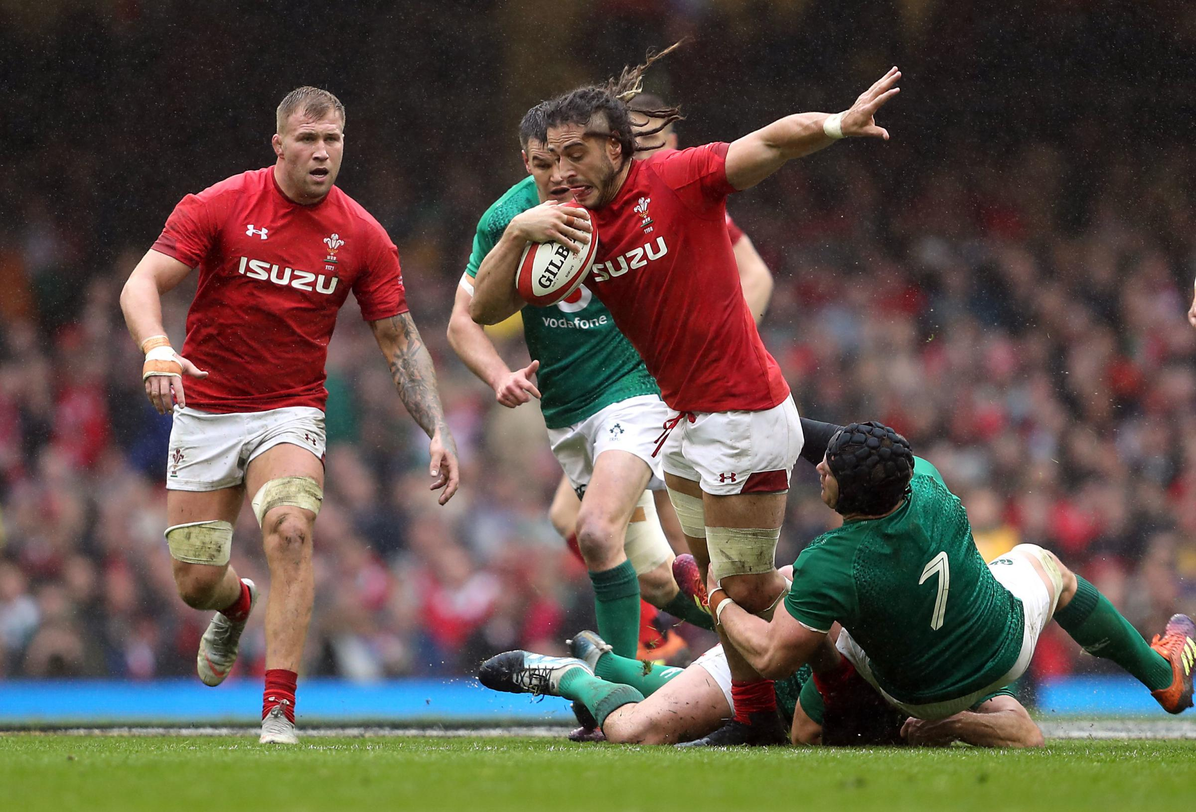 Wales' Josh Navidi (centre) is tackeld by Ireland's Sean O'Brien (right) during the Guinness Six Nations match at the Principality Stadium, Cardiff. PRESS ASSOCIATION Photo. Picture date: Saturday March 16, 2019. See PA story RUGBYU Wales. Pho