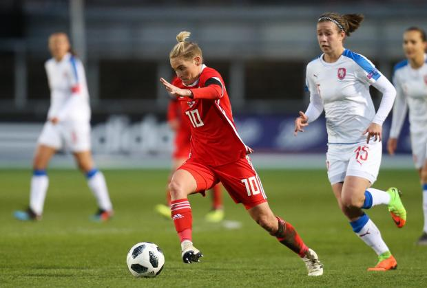 Penarth Times: STAR: Jess Fishlock on the charge for Wales at Rodney Parade