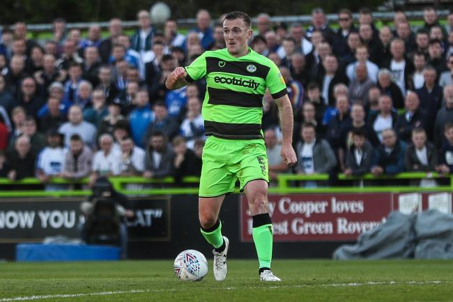 Forest Green Rovers Lee Collins(5) on the ball during the EFL Sky Bet League 2 second leg Play Off match between Forest Green Rovers and Tranmere Rovers at the New Lawn, Forest Green, United Kingdom on 13 May 2019..