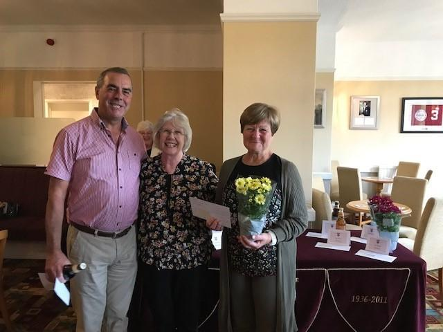 Lady captain Linda Lee presenting the prizes to Jeff and Lynda Hudd