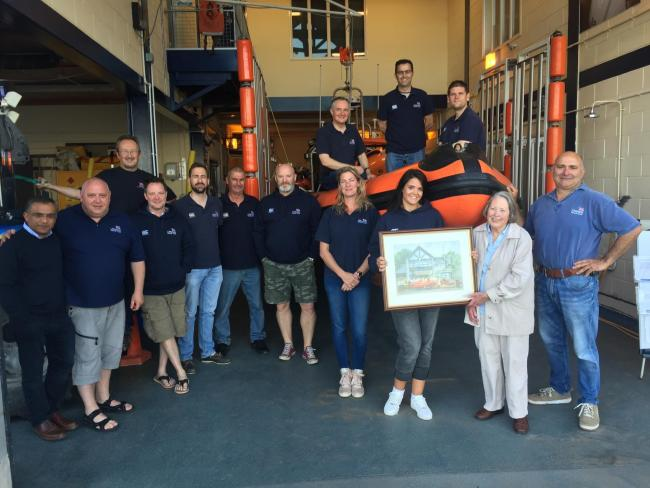 Members of crew, including trainee Heather Roman-Robinson receiving picture from Diana Mead, right. Picture: Penarth RNLI