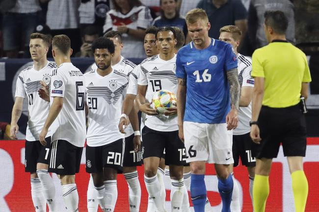Germany's players celebrate their side's sixth goal against Estonia in Mainz (AP Photo/Michael Probst)